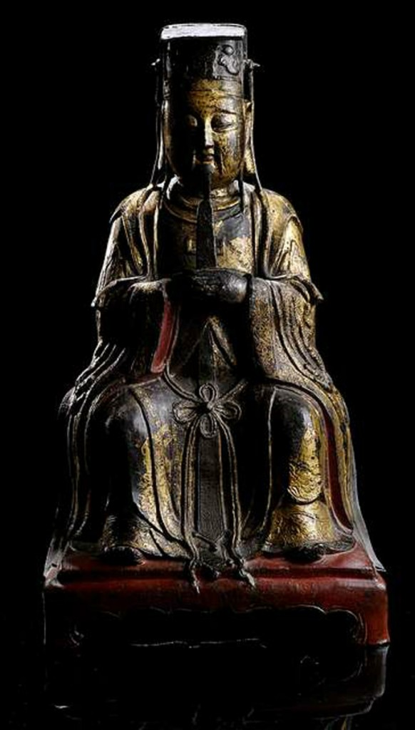 MING DYNASTY, GILT, RED AND BLACK LACQUERED BRONZE FIGURE OF DIGNITARY