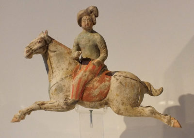 Female Polo Player Astride Galloping Pony (1)