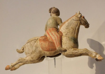 Female Polo Player Astride Galloping Pony (5)